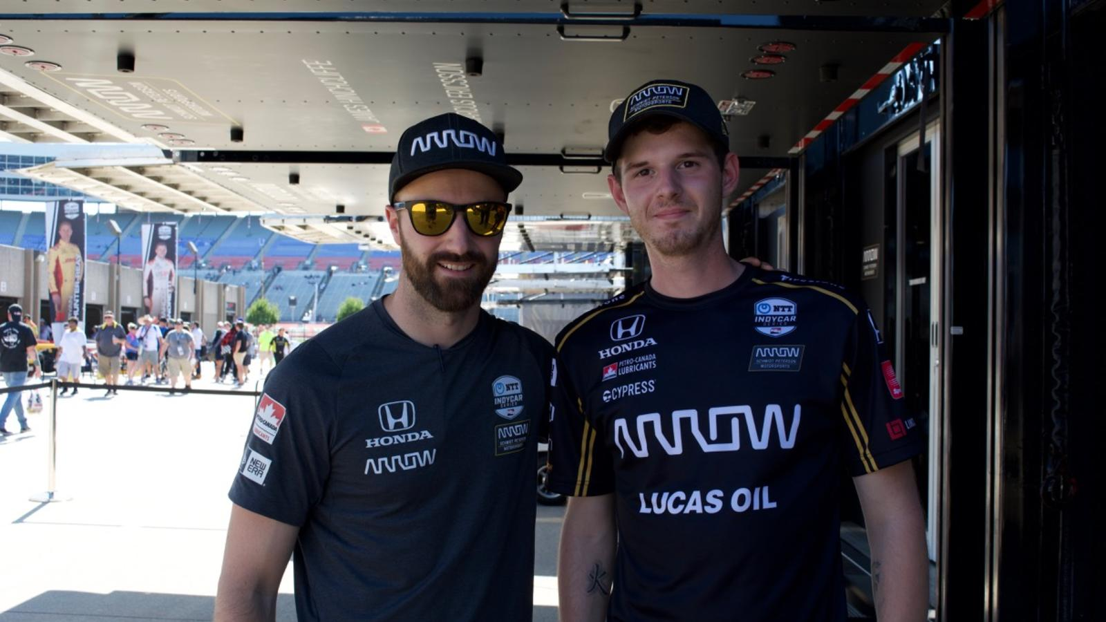 Evan Roberts of the Lincoln Tech Grand Prairie Campus with team driver James Hinchcliffe