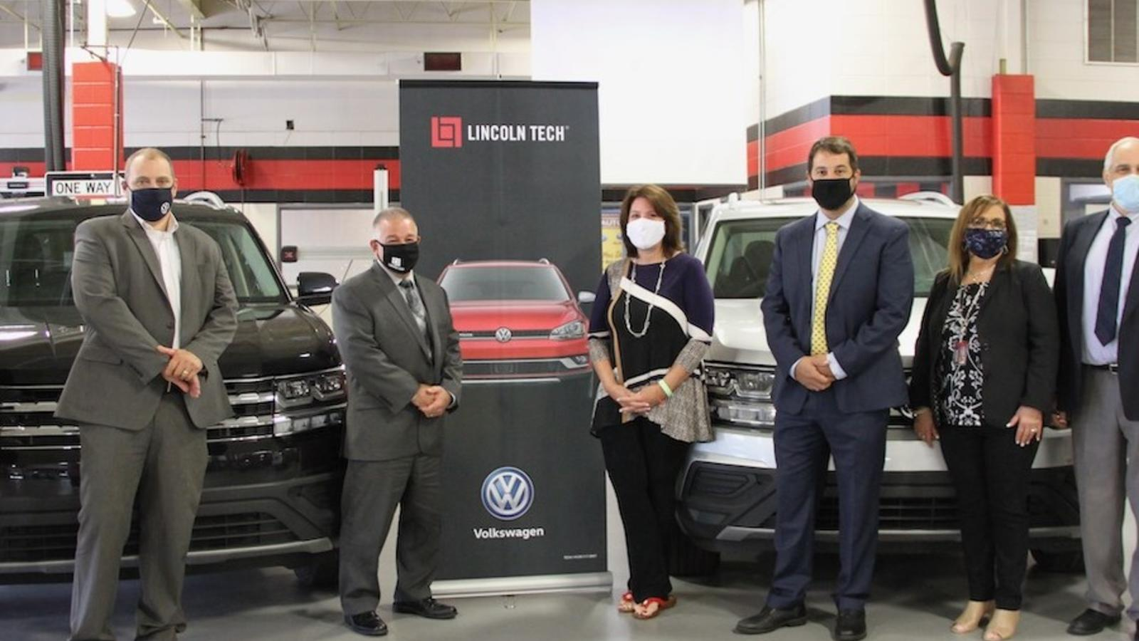 Representatives of both Volkswagen of America and Lincoln Tech meet to accept two new VW Atlas vehicles into the Lincoln Tech training fleet.