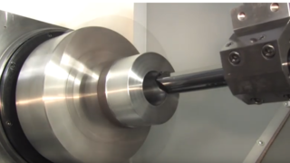 A CNC lathe in action.