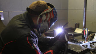 A welding student at Lincoln Tech's Denver campus trains with an ARC welder