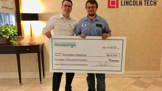 Lincoln Student with scholarship check