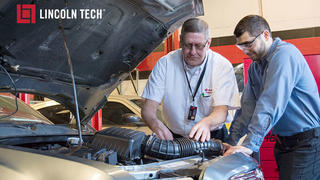 Students work with an auto instructor at Lincoln Tech