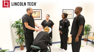 Students learn massage therapy techniques from a Lincoln Tech instructor