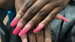 nail extensions with decorative art work.