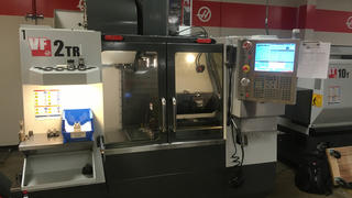 The VF2TR shown is a Haas Vertical Milling Center