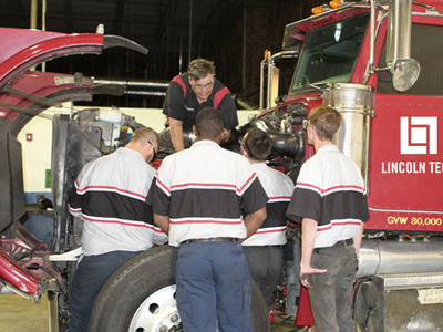 A diesel instructor teaches a group of student technicians proper diesel engine diagnosis