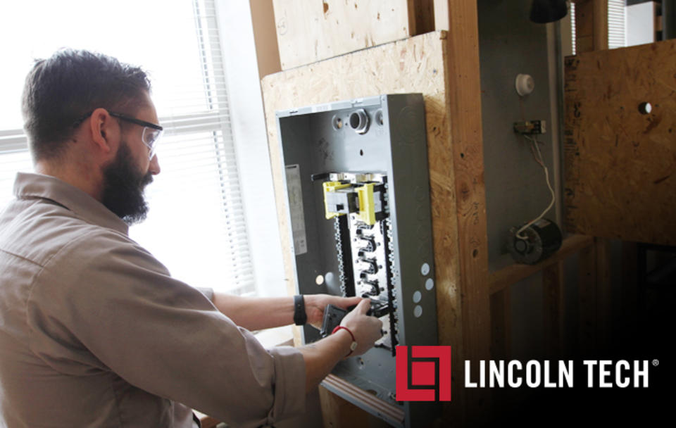 A Lincoln Tech Electrical Program Student works on building a circuit breaker box